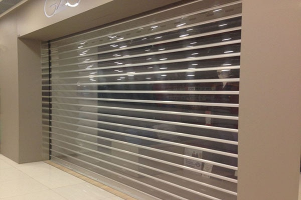 With the lapse of time, we gained experience and became proficient in the manufacturing and supplying of a comprehensive range of premium quality Polycarbonate Rolling Shutters. Electrically operated, these shutters offer an easy and hassle free operation. In addition to this, the entire range of best quality shutters offered by us is extensively used at shopping malls.  Features:-     High security - near steel strength     Ideal for shopping malls and high profile shops     Custom made - to fit every opening perfectly     Electrically operated for fast easy roll up and roll down operation.