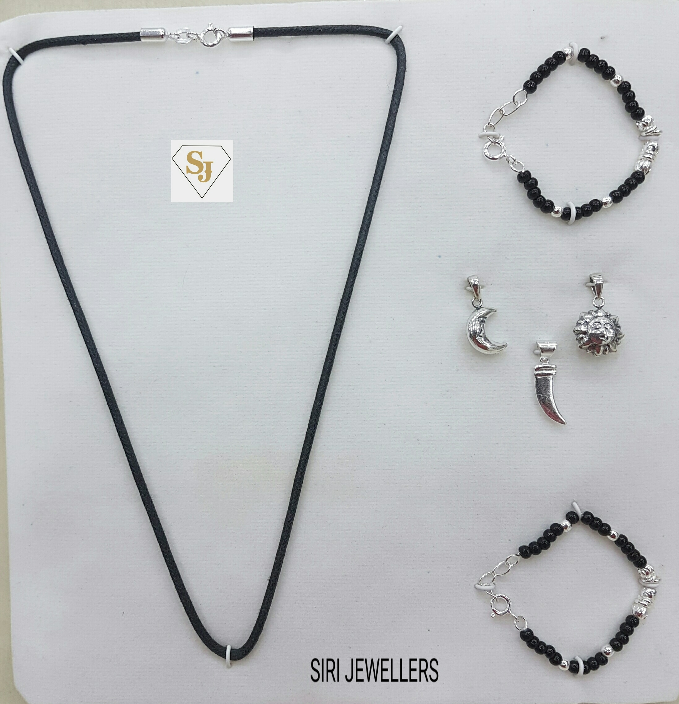 92.5 Silver baby set for new borns the pack contains 2 drushti bangals one black thread and 3 pendents .... very unique item .. lets welcome the baby by adding more colourfull gifts