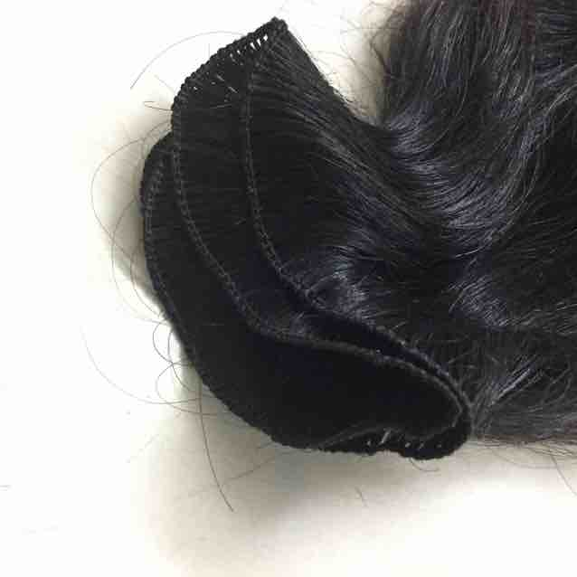 Few strands are taken by fingers and tied to 3 threads manually and knotted to make thinnest weft. This is called