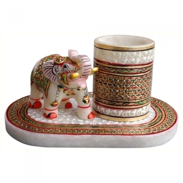 Marble Table Top Pen Holder with Elephant are made by the hands of the expert artisan from Jaipur with hand Painted Art work which gives the decorative look to table top  which is use for decor as well as gift purposes.  PRODUCT SPECIFICATION: *Material-Marble *Color-White , Red and Multicolored Hand Painted art Work *Application- use for decor as well as gift purposes , corporate gift , personalized gift