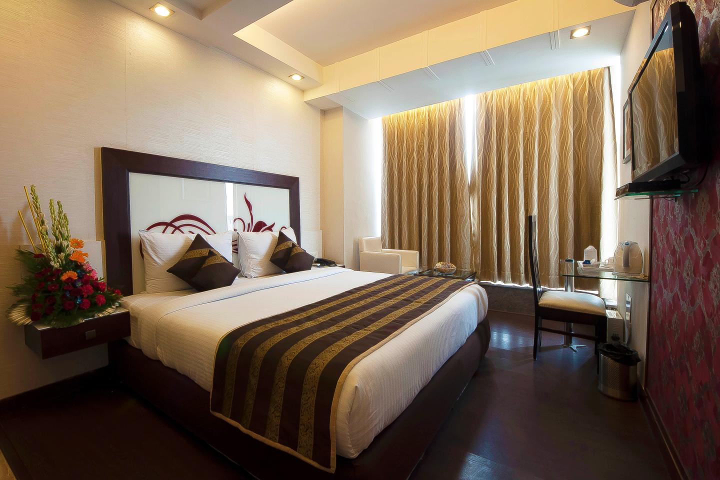 Within an easy reach of Connaught Place, Pitrashish Premium is within a 20-minute drive of tourist hotspots like India Gate, Red Fort and National Agricultural Science Museum. Catering to the needs of business travellers, the property offers meeting facility and free high-speed Wi-Fi access. The ho tel offers 24 guestrooms that are exquisitely furnished with dark tone furniture and have distinct interiors. Work desk, LCD TV with cable connection, telephone, individually controlled air conditioning and tea/coffee maker are the common in-room amenities. Attached bathrooms are provided with hot and cold water and toiletries. Avail the services offered by the well-informed travel desk of the hotel and get acquainted with diverse facets of the national capital of India. In addition, 24-hour room service, laundry, parking area and free Wi-Fi service are also provided by the hotel.