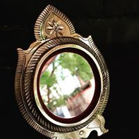 Aranmula kannadi (Malayalam: ആറന്മുളക്കണ്ണാടി, meaning the Aranmula mirror) is a handmade metal-alloy mirror, made in Aranmula, a small town in the state of Kerala, India. Unlike the normal