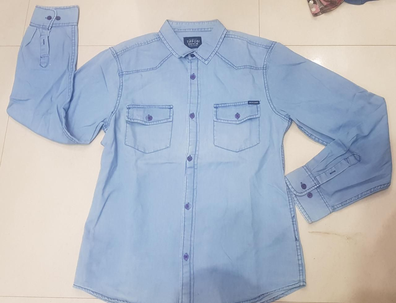 STOCKLOTS AVAILABLE - KIDS DENIM SHIRT  STYLE –  KIDS DENIM SHIRT  FABRIC - 100% COTTON SIZES - 6, 8, 10, 12, 14 COLOR - DENIM BLUE  PACKING - SINGLE PCS IN POLY BAGS QTY - 1000 PCS DELIVERY - READY IN STOCK