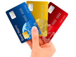 A credit card is a payment card issued to users (cardholders) to enable the cardholder to pay a merchant for goods and services based on the cardholder's promise to the card issuer to pay them for the amounts so paid plus the other agreed charges.[1] The card issuer (usually a bank) creates a revolving account and grants a line of credit to the cardholder, from which the cardholder can borrow money for payment to a merchant or as a cash advance. In other words, credit cards combine payment services with extensions of credit