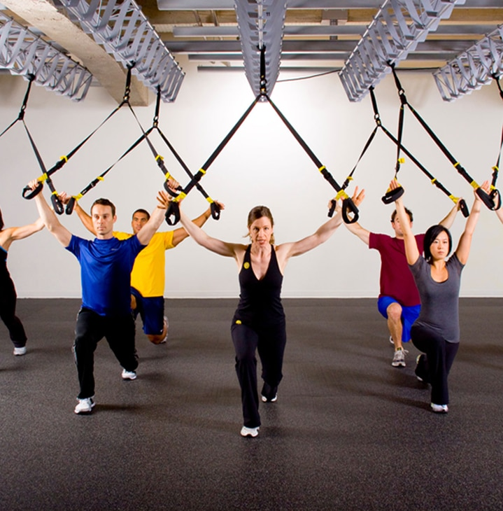 Born in the Navy SEALs, Suspension Training bodyweight exercise develops strength, balance, flexibility and core stability simultaneously.  It requires the use of the TRX Suspension Trainer, a highly portable performance training tool that leverages gravity and the user's body weight to complete 100s of exercises.  Workout Using the Suspension Trainer  The TRX Suspension Trainer is the original, best-in-class workout system that leverages gravity and your bodyweight to perform hundreds of exercises.  You're in control of how much you want to challenge yourself on each exercise - because you can simply adjust your body position to add or decrease resistance.  THE TRX SUSPENSION TRAINER: Delivers a fast, effective total-body workout Helps build a rock-solid core Increases muscular endurance Benefits people of all fitness levels (pro athletes to seniors) Can be set-up anywhere (gym, home, hotel or outside) By utilizing your own bodyweight, the TRX Suspension Trainer provides greater performance and functionality than large exercises.