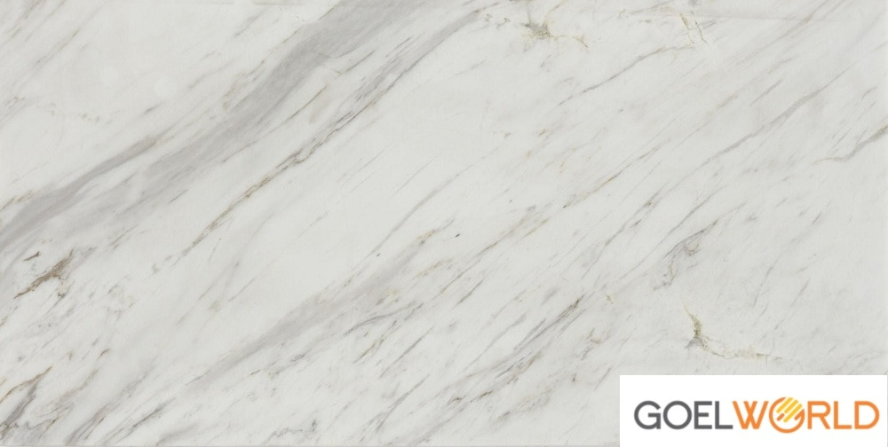 Volakas Marble is an elegant natural stone featuring a white background accented with veins of gray and swatches of pale burgundy. This versatile material compliments many design styles.