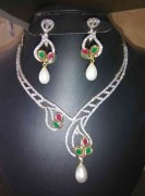 ridas ad with ruby and emerald stone necklace