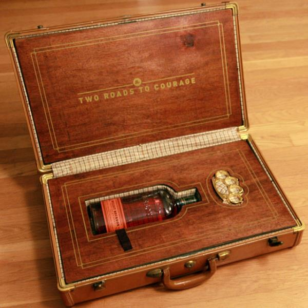 Vintage gift briefcase for liquor and a fist weapon.