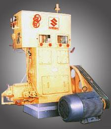 The Expansion Engine is a vertical single acting reciprocating type engine.  Expansion Engine SANGHI - ORG Expansion Engine  High Pressure Expansion Engine SANGHI - ORG High Pressure Expansion Engine   The Electric Motor is used initially to start the machine. Thereafter the engine is moved by the air pressure itself and during which time, the engine motor retains the speed by acting as a brake. Since work is done by air in rotating the Flywheel, it loses its heat content (enthalpy). Thus the air gets cooled. This cooling is more than that of an expansion in an expansion valve. The Expansion Engine can be considered as three major units: a. The drive unit. b. The Cylinder Unit for air expansion and c. The Hydraulic Systems for operating the Valves.  The High Pressure Expansion Engine is used for liquid Plants