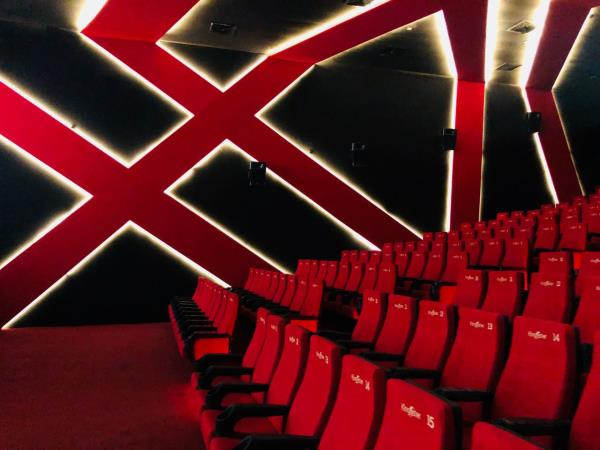 Welcome in the fascinating world of Entertainment Industry and your ultimate destination for making dream project of setting up a Cinema/ movie theater in your area. We at Cinema World believe in profound principles of planned approach in availing the best business results for our clientele. Setting up a Cinema/ Movie Theater in early 1950s remained a Premium Sector Service offering perspective.India has revolutionised in last few decades and technology has ushered new dawn for Entertainment Industry to grow manifold with rising focus on entertainment as key element in social life. We at Cinema world are glad to pioneer in standardising, simplifying and modernise this entertainment industry arena with our set of offerings. We offer following services in setting up a Cinema Theater:Market Research & Budgeting: Understanding your planned Location Locality, demands, expectations, current market scenario, young generation life style, society and overall factors helps in estimating your planned Theater. We do intensive local level researches to arrive at Budgetary aspects for such proposals so as our prospective clients get best Returns on Investment.Business Model: There is a myth in Entertainment industry with reference to earning estimation for running a Cinema Theater that Cinema Theater/ movies hall runs and avails good profits only in big cities (tier-2 onwards) where population is above 5Lakhs. We at Cinema World mark distinguish change in this understanding and we strongly believe that Cinema Theater/ Movie Hall can give good returns on investment even in Taluka/ Tahsil places with population in range of 60,000 to 100,000. (5/8 km Circle from Cinema Point). A single screen theater runs well on average with 2,500 viewers a week taking per day count to 350+ visitors a day in 4 shows.License(s) and various Legal perspectives: Being large public area and entertainment resource, Cinema Theaters attracts mandatory need of various Liceneses and permissions from Local governments (Council/ Municipal Council/ Corporation), Public Works Department (PWD for Plan Approval), District Authorities (Health and Fire departments), State Electricity Company (for Electricity connection), District Collectorate Entertainment department. Apart from these licenses, many States have their own policies and legalities involved.Design and Construction: Building Architecture is the most important and vital element of this entire setup. Modernised Building Architecture, plush interior look, glamourous eye-catching colour schemes, kids friendly areas, waiting lounge with cheerful ambience, ample secured in-house parking space are amongst various key elements that we look forward with utmost excitement as a viewer to avail the best of your feel.Seating and Air-conditioning: A visitor spares 3+ hours in a cinema theater and hence it is really important that the seating arrangements and Air-conditioning of the entire cinema hall keeps clear focus on availing the best comfort and pleasant joy.Seats are broadly categorised in fixed seats, push back seats, motorised recliner chairs/ sofa and we look forward to avail multiplex level comfort by offering best cushioned, PU foam chairs on lowest levels and have recliner sofa setup for royal treats.Air conditioning is yet another enhancement aspect wherein you could offer Split, Cassette/ Ceiling or centralised air conditioning systems in your planned theater based on your budgets/ plan.Screen: Technology has made a revolutionary change in screen viewing. We can choose from Silver Screen, White Screen, 3D Screens to project/ Cinema/ Movies in theater. Screen size can be best decided based on your Hall Size, Project room distance and various other aspects.Projection: Showing Cinema in theaters demand dynamic understanding of changing life style and use of technology in showing the latest released movies at earliest span of time for getting best revenues. The super hit mantra of First day First show (FDFS) is practically possible now with use of Satellite project techniques. These project systems equally offers crystal clear picture viewing, excellent digital sound quality and light effects for uninteruppted joy of viewing cinema in theaters. We strongly recommend our prospective clients to adopt this ultra-modern technology tool for delivering latest pictures/ movies in their halls. This technology has outdated traditional film based projector systems wherein one has to depend solely on prints and time taken to reach and again various quality concerns and resources requirement. Satellite projection cinema technology has equally reduced resource requirement to lowest extent.Sound: Use of Dolby Processors, Amplifiers and best sound speakers for utter joy of best hearing quality is amongst most significant perspective to get your visitor enjoy the best of movie.Booking Window: We avail complete reference, support and services for staff feeding, office setup, work planning, resources training and computerised ticket/ online ticketing requirements of theaters.Distributor Linkup: Linking up with best distributors to get continued films with FDFS priority is most attentive perspective. We at Cinema World give extensive training, distributor linking and knowledgebase sharing for this important aspect.Cafeteria: Theater's major second revenue comes from cafeteria wherein most of visitors enjoy dedicated seating with their families and loved ones while watching movies. Hence having clear display of cafeteria serviecs, uniformed staffing, popcorns, cold drinks, pizza, burger, sandwich, machinery setup are keenly reviewed and availed.Management and Business Planning Consultation: As you are all set to enter in Cinema World, we are here to assist you with the best professional experience to avail quality all around. We offer Theater Launching plan, Opening Day Planning, Print Media Planning, Invitation Cards, Resources Training, Internal Accounting, Tax Accounting and Planning, Auditory reviews services for your Theater plan.