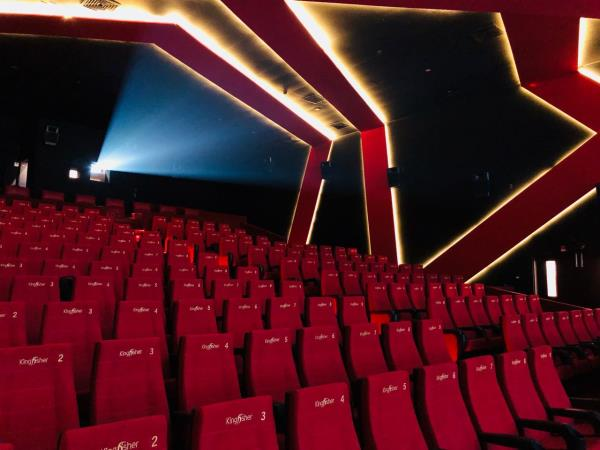 The luxury cinema concept marries two ideas, that of luxury and cinema.To satisfy the wide range of premium theatre themes and designs, Seating Concepts offers many different luxury and VIP options.A luxury theater concept starts with many waiting areas designed for comfort and relaxation, outdoor with patio heat lamps, a lobby with a bar, quieter and less traffic, a sitting area with a big screen TV, cafe, restaurant, patisserie and a book shop devoted to movies.The floors are carpeted and have approximately five feet of space between seat and the seat in front. The cushion seats has an attached swivel tray, custom swivel dining tables, a cup hold nestled in the armchair, and a button that makes the seat recline and prop up the foot rest. There is also a service call button for food or beverages (alcoholic and non-alcoholic drinks) delivered to your seat.Customers enjoy a unique VIP movie experience on par with the finest in-home movie theaters and lounges. In surroundings that range from a fully recliner seating, 2K/4K digital projection, finest surround sound and complete 3D capability.This combination of cinema and dining ensure luxury Movie Theater becomes a cultural and entertainment landmark which is now a trend in India.Luxury Cinemas have state of the art kitchen equipment & full bar service.