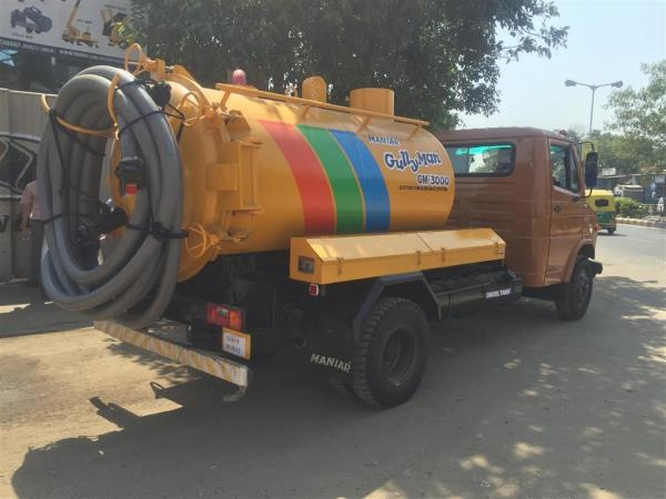 MANIAR 'GullyMan' is an advanced technology with a blow-back system for cleaning cesspit, cesspool and manhole chambers. This Machine is capable of creating a very high degree of air pressure which breaks the silt sedimentation that gets accumulated at the bottom of the cesspit, cesspool and manhole chambers. It is equipped with major IMPORTED components including its unique heavy duty Vacuum Pump. It is capable of sucking particles up to 40 to 50mm dia along with sludge from a distance of 100 feet and depth up to 25 feet. The tank can be tilted (optional) at a specified angle and the hinged type rear door can be opened and closed hydraulically to drain out the collected liquid waste or silt. Utmost care has been taken to install adequate safety devices such as Auto shut-off valves, Imported Siphon filter, Safety pressure release valve, Quick release coupling are few safety features among those safety instruments, which ensure that the equipment operates with safety & avoid chances of occurrences of an accident.Vehicle: TATA, Eicher, Ashok Leyland. 7 Tonner VehicleSludge Tank Capacity:  4000Material: Mild Steel of 5 mm thicknessSuction Pump: Imported Italian makeCapacity: 390 m3/h Power for Vacuum Pump: Is taken from Side PTO / Split shaft PTO.Suction Hose dia: 3