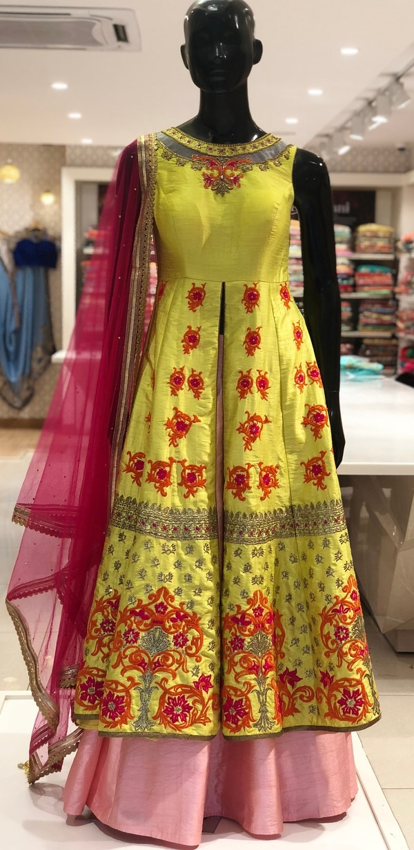This Indo Western Dress is a take on traditional Anarkali Suit made on Raw Silk to give it a rustic yet elegant finish. The top is designed with Zari, Stone and Thread work and the Long Skirt is made on plain Raw Silk. The Dupatta is made on Net embellished with stone. Only at Mayeeka.