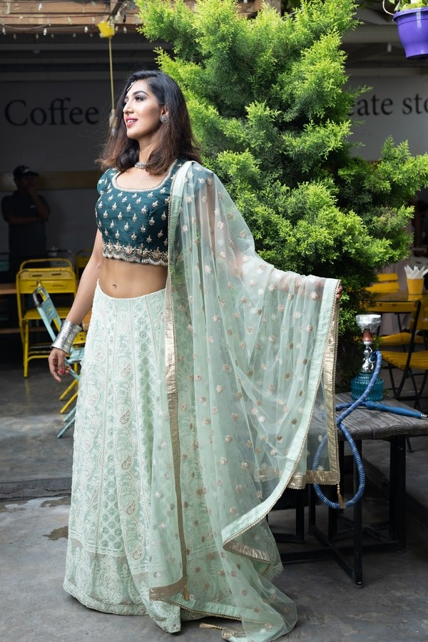 Featuring an ethereal Chikankari Emerald Green Lehenga, with translucent overlapping sequins on the blouse