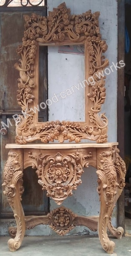 Best teak wood carving console table set with mirror frame size 4 feet by 7 feet height full carving hand design best quality teak wood with polish finish natural teak wood colour this console table this design only on order for ready time to work 30 order