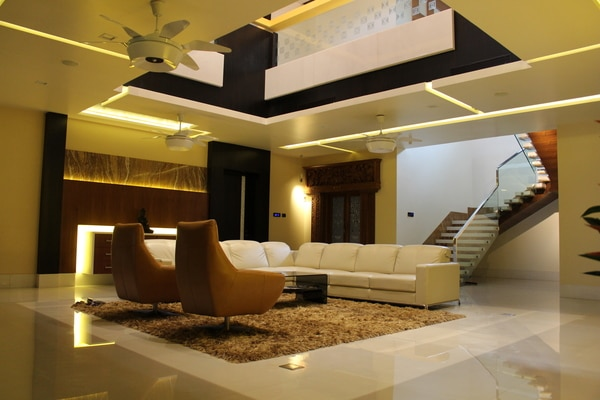 High end villas interiors with modern designs with play of different materials. Italian marbles, Veneers and laminates, Wooden flooring, Corian finishes, Designer glass etc. to create a state of art to portray status of the clients.  The entire space is connected with double ht atrium space  which is the focus of the home and breathing space for ground and first floor. It is lite with a imported designer chandelier.