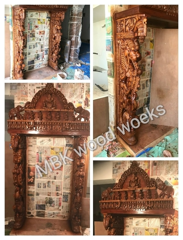 Wooden carving designer modeler open pooja mandir Best hand working carving design Good quality teakwood used nicely model pooja mandir size 4 feet width and 7 feet height in to in pooja size 5x3 side figure pillar design 6 inches thickness Deep 18 inches this model only on order for ready time to work completed by 60 days cost 4,60000